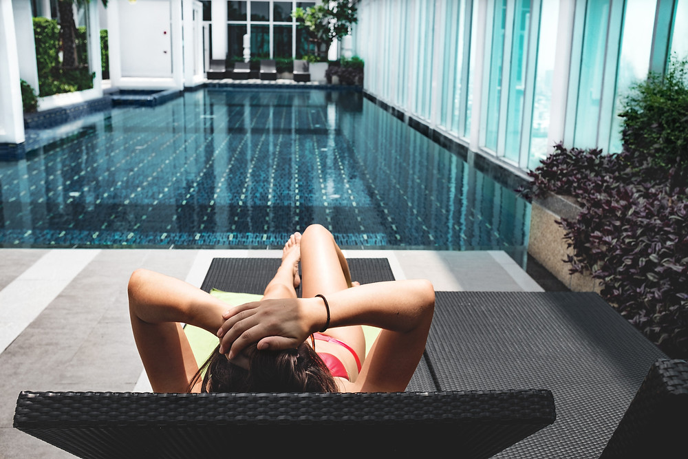 woman resting by a pool