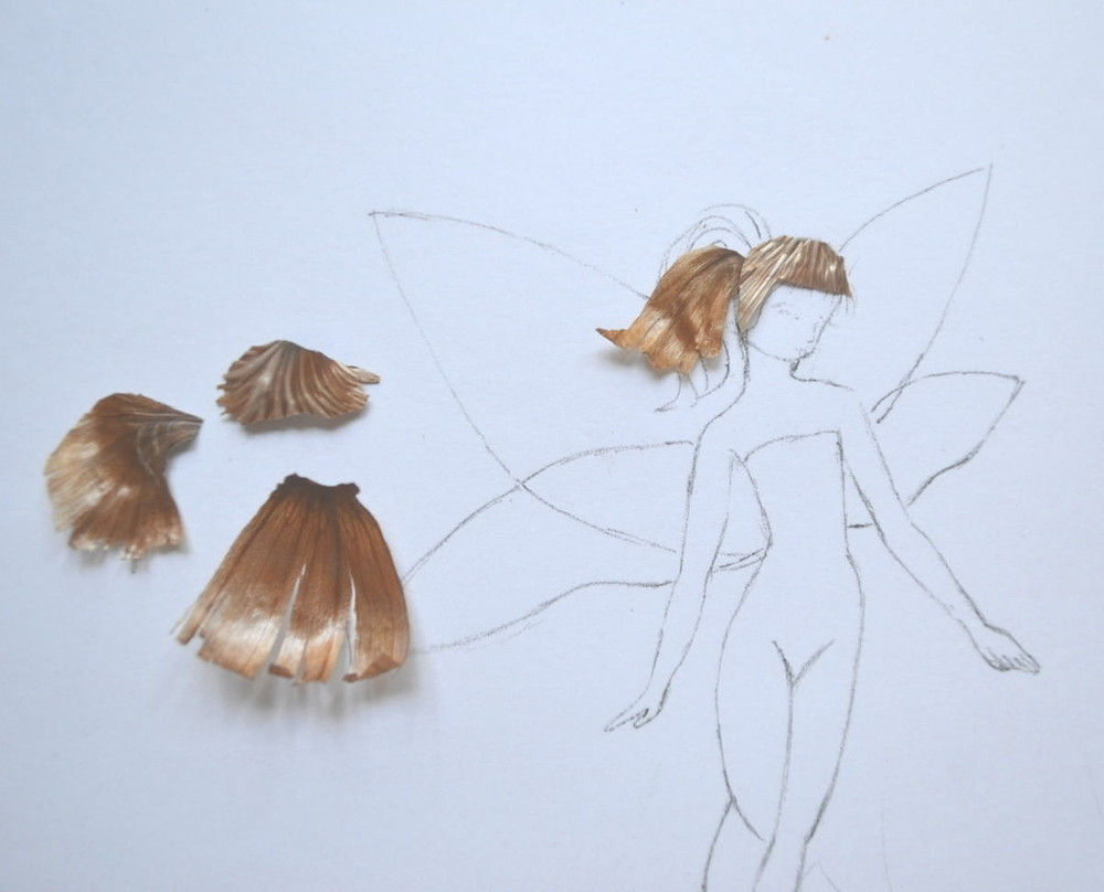 """The sketch of the Pressed Plant Art """"Space Fairy"""" and the skin of gladiolus bulb on it."""
