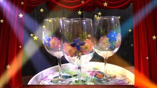 Pressed Flower Crafts on vine glasses. Three vine glasses decorated with pressed flowers.