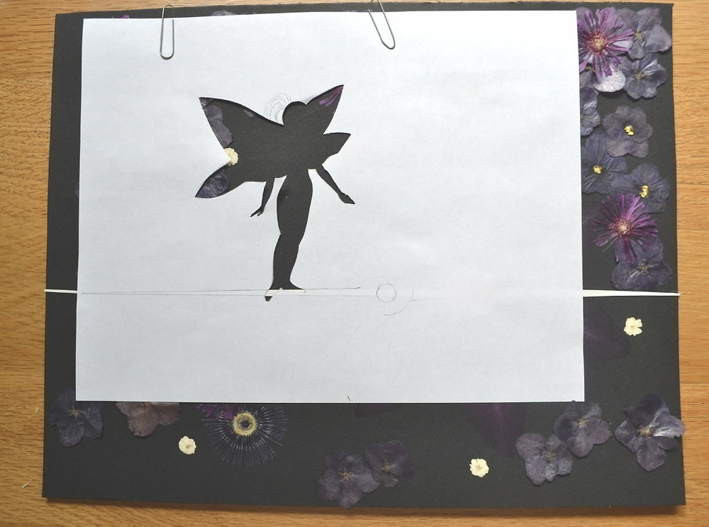 """The stencil of the figure of Space Fairy on the surface of the Pressed Plant Art """"Space Fairy""""."""
