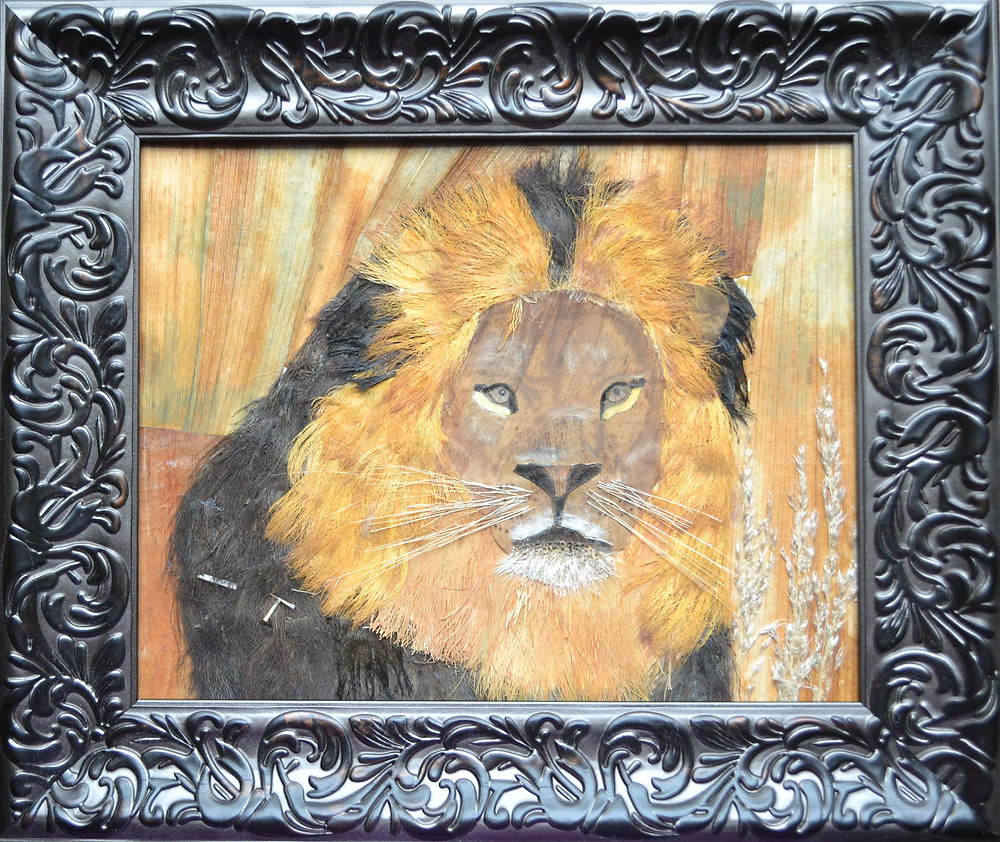"""Original Pressed Plant Art """"Lion"""". A lion is standing among grass."""