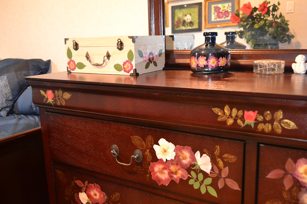 Jewelry box with Pressed Flower Crafts is on the dresser.
