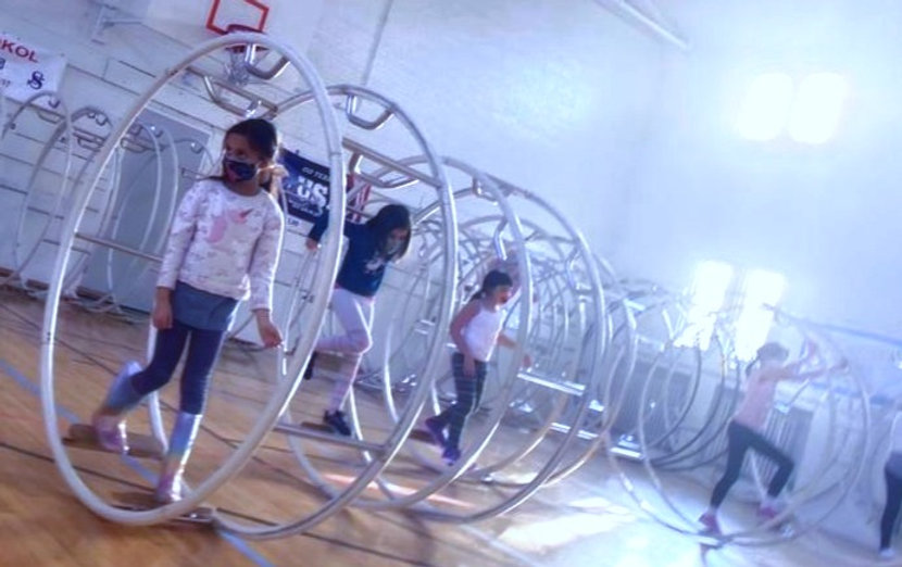 Kids practicing Gym Wheel