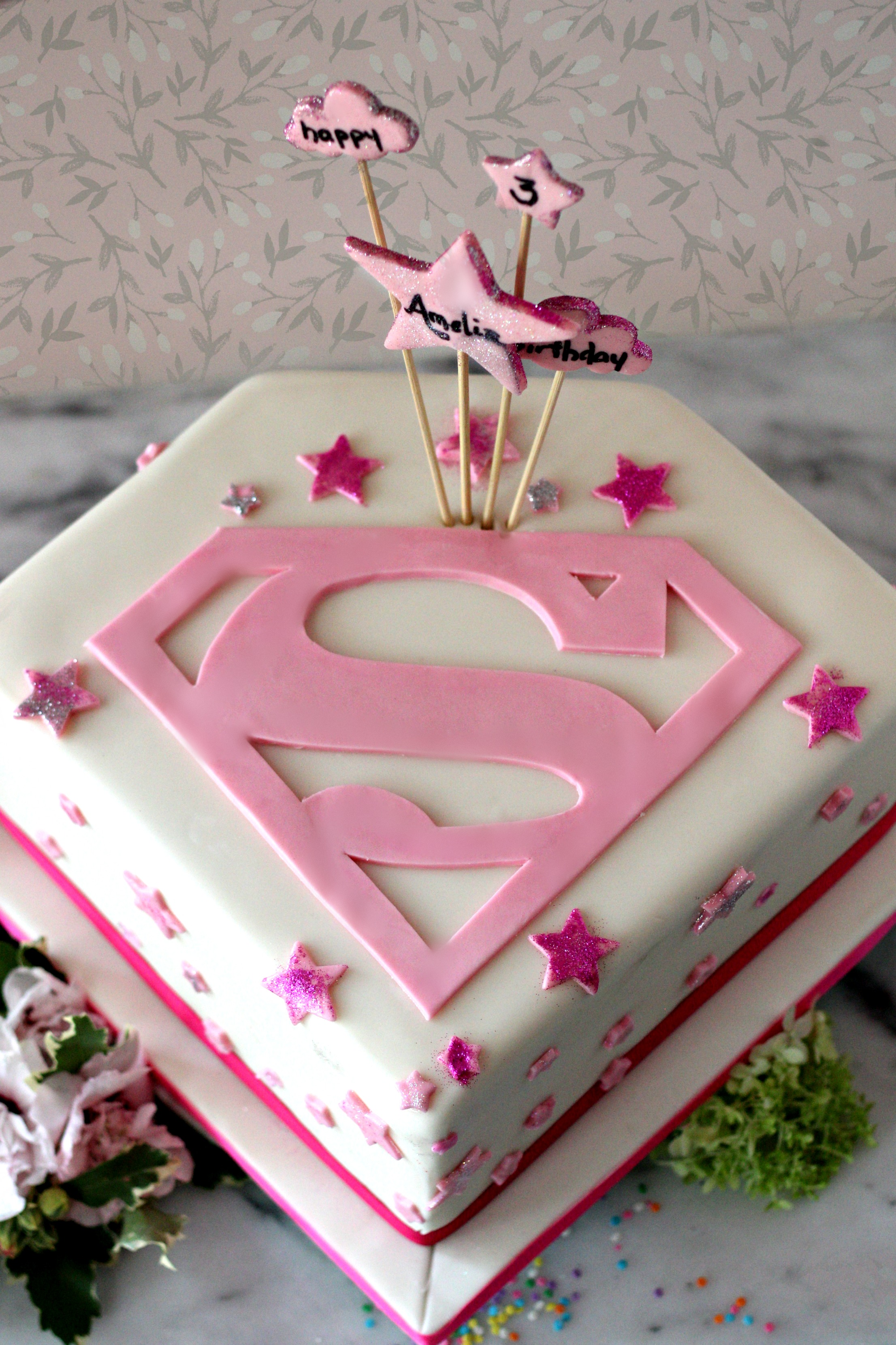 supergirl pink birthday cake e