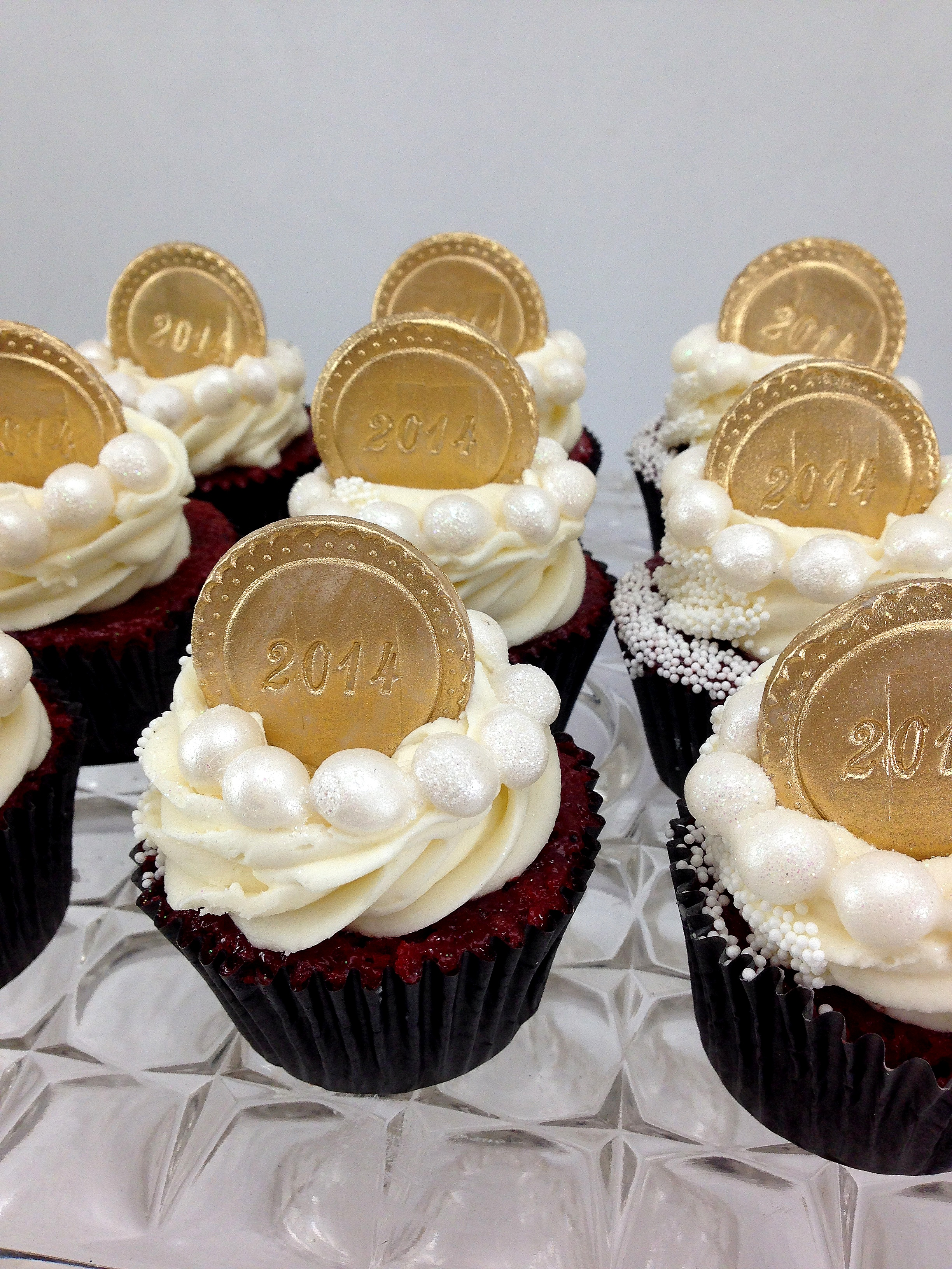 Red Velvet graduation cupcakes pearls and coin.jpg