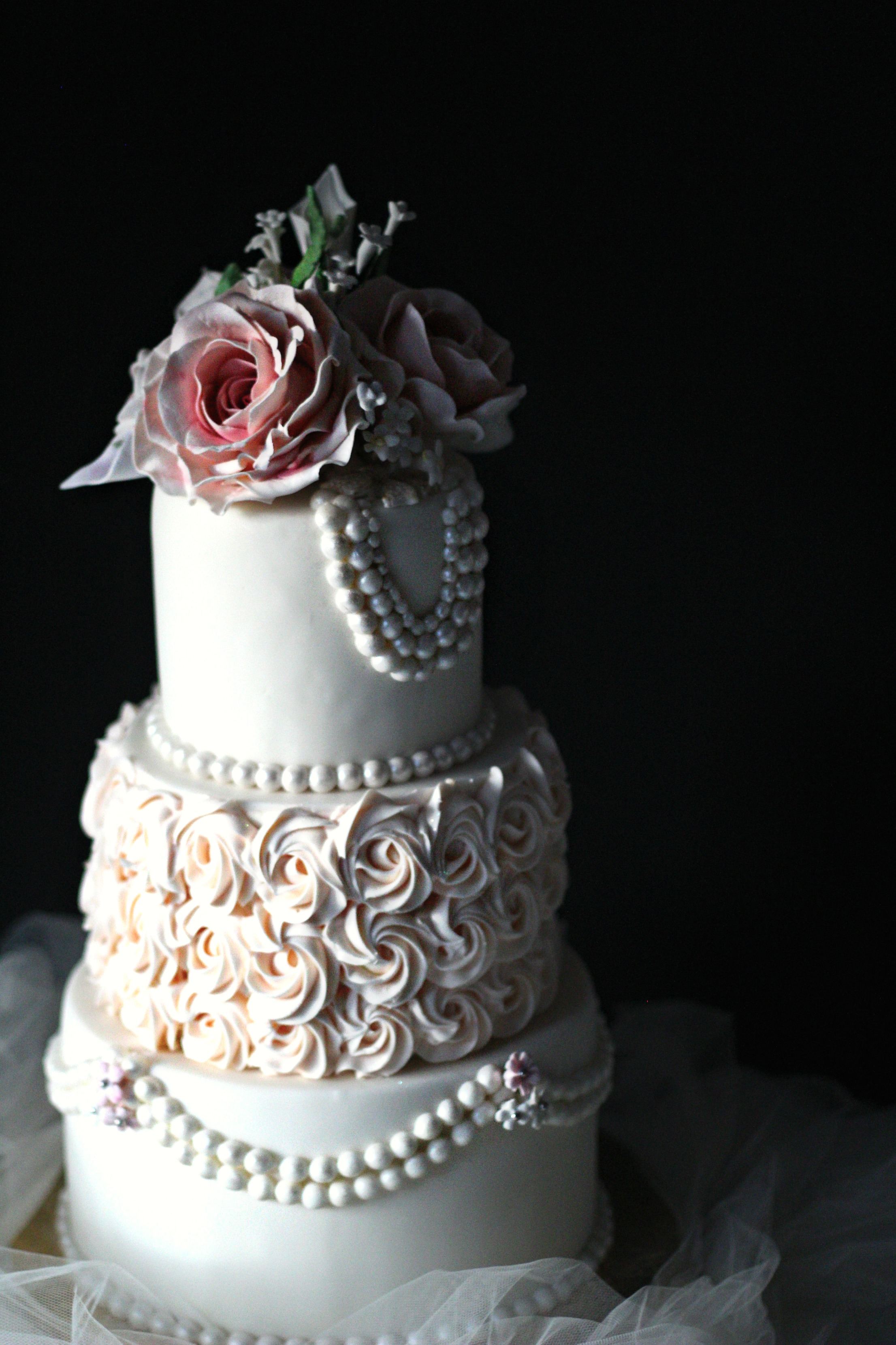 top three tiers pearls and roses wedding cake pink rosettes e