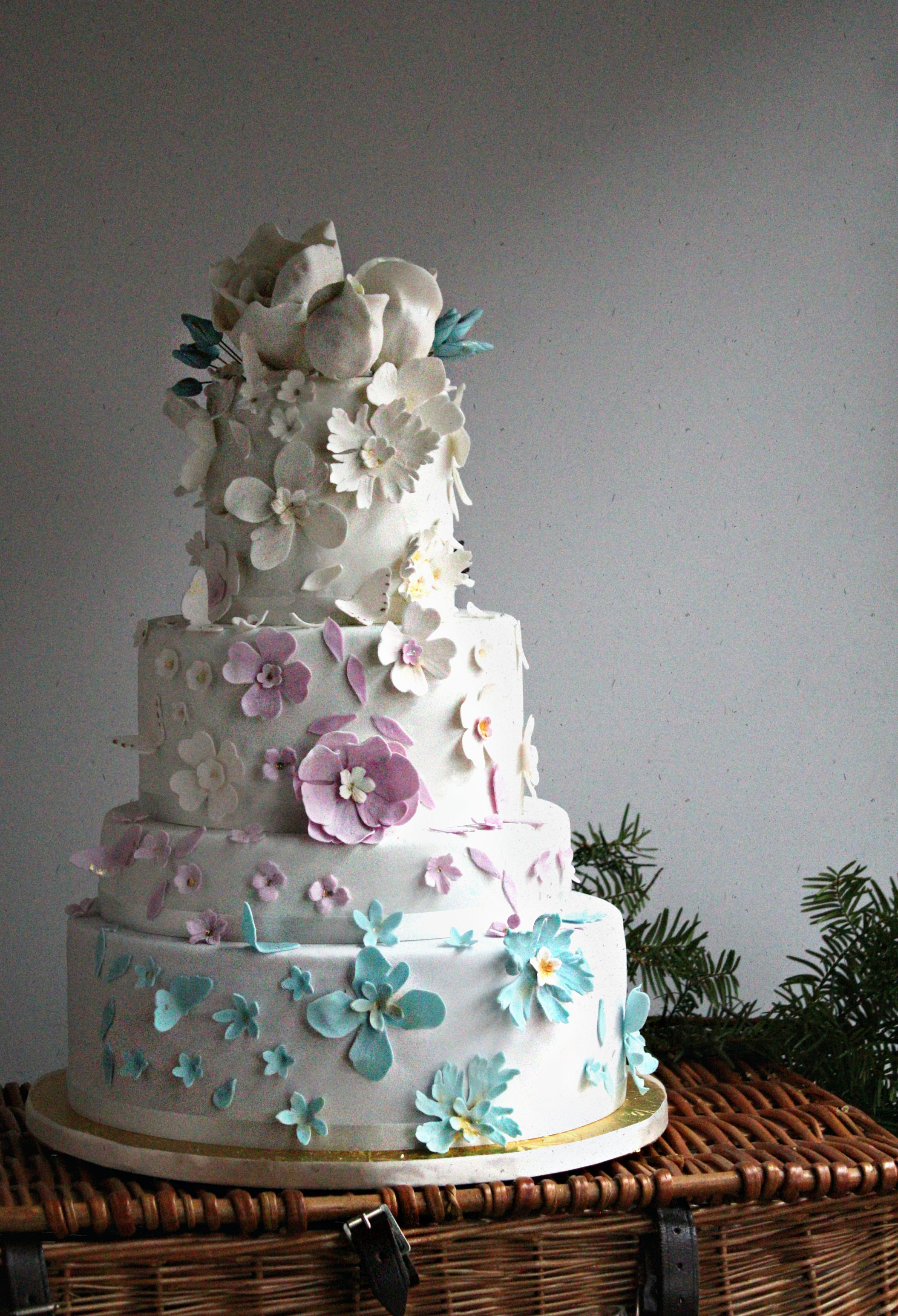 ombre lavender wedding cake multicolored sugar flowers e