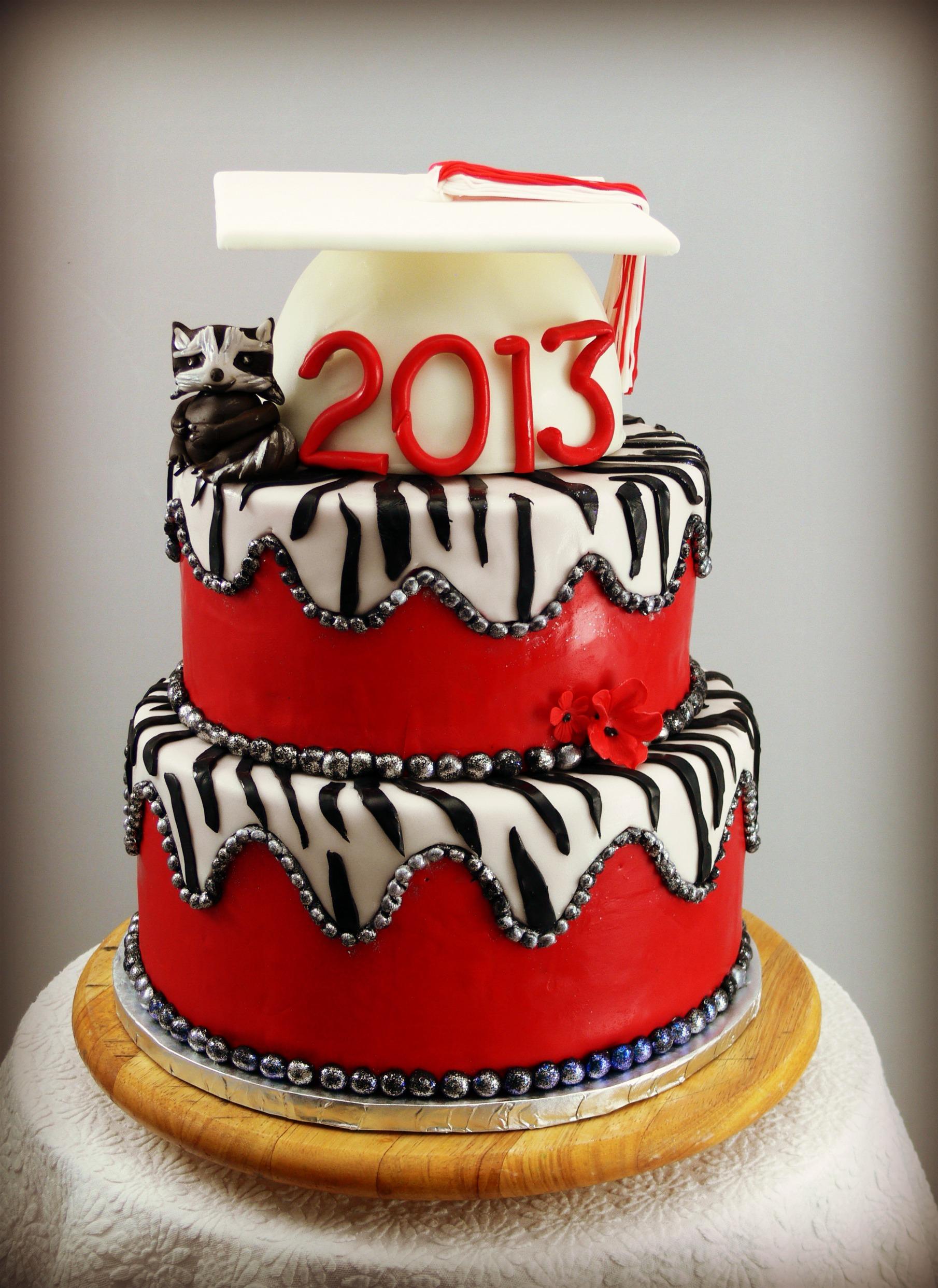 Red Velvet Graduation cake with zebra and raccoon.jpg