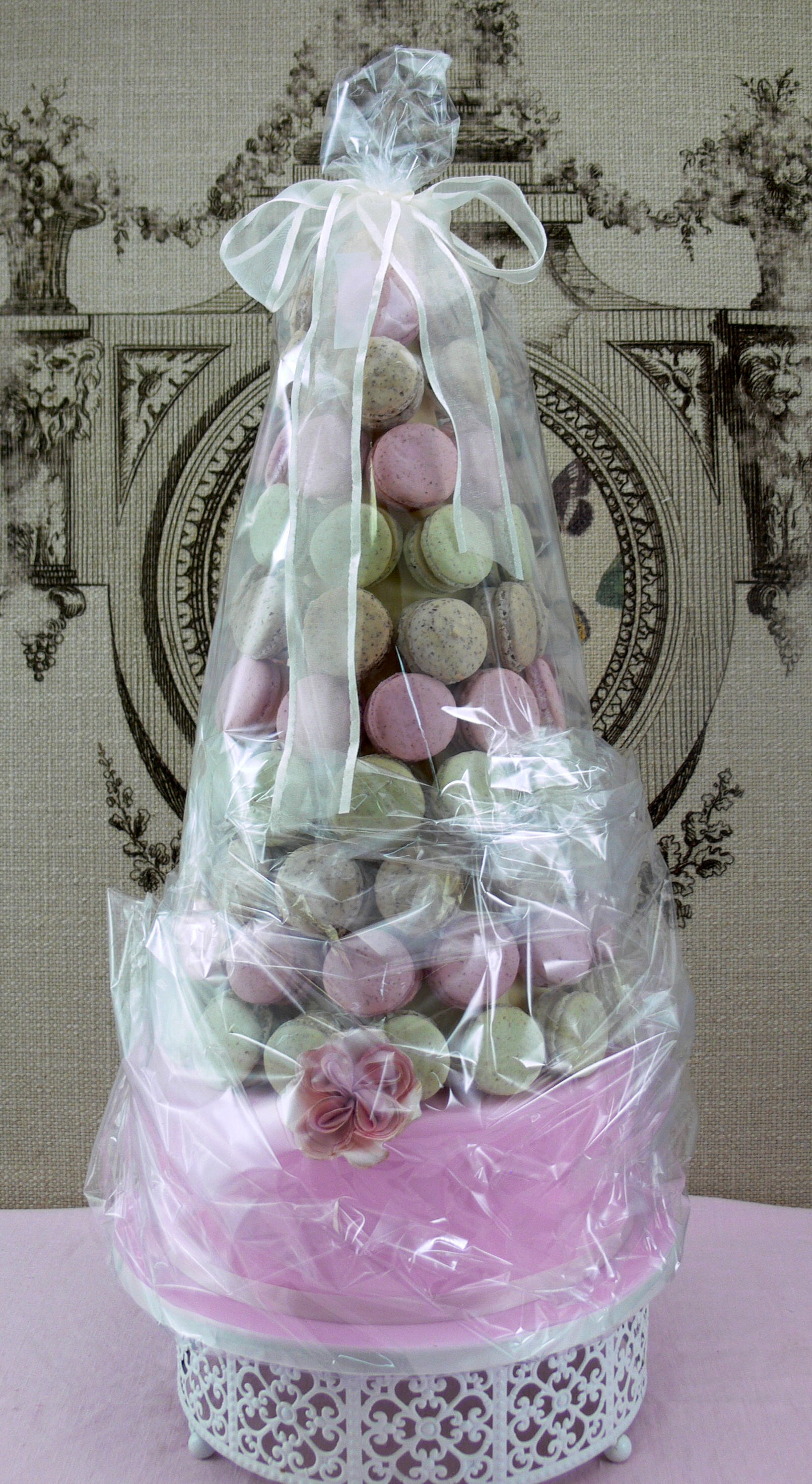 Laduree style Macaron Tower wrapped for delivery in cellophane and ribbon.JPG