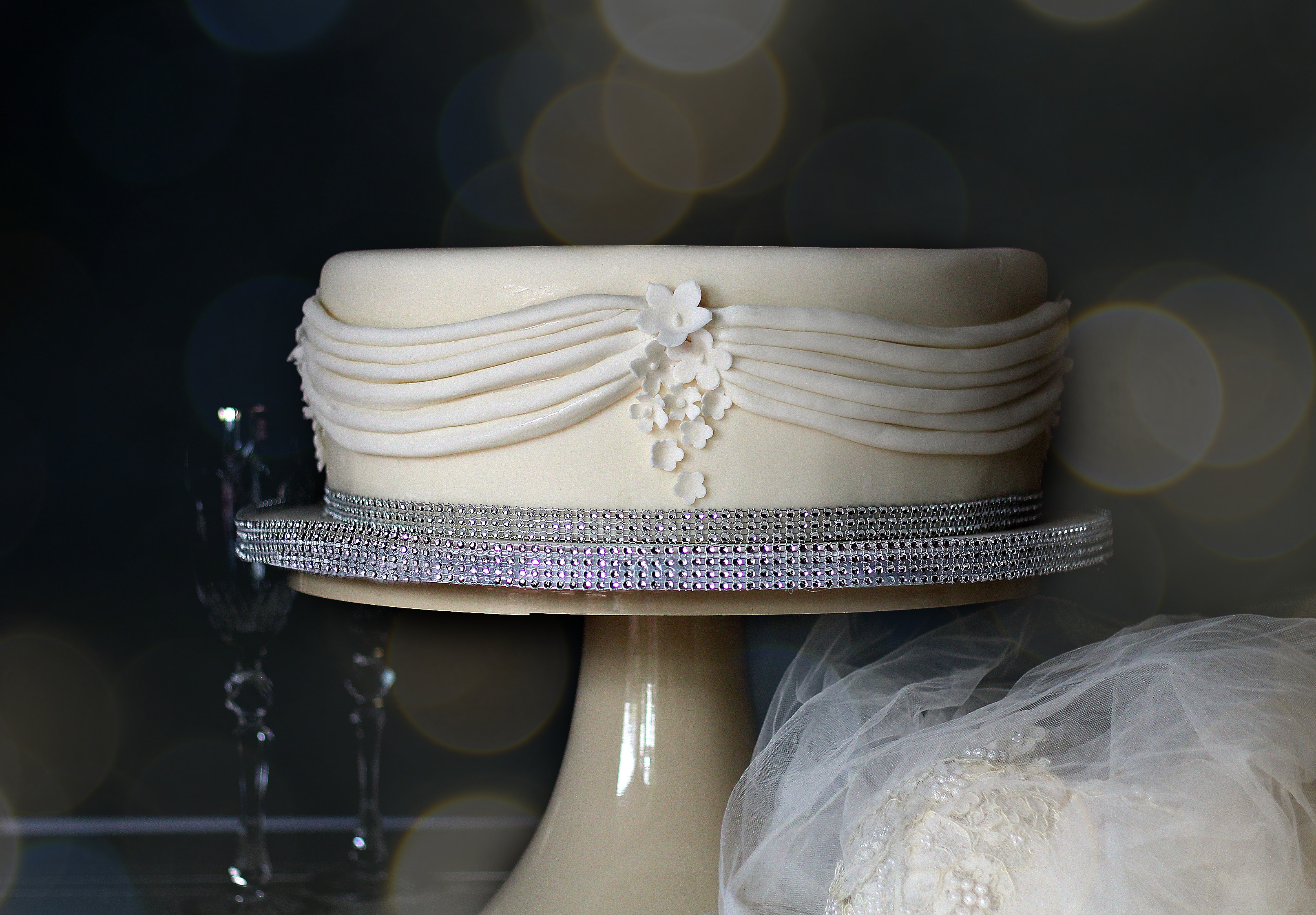 bottom tier; neoclassical white wedding cake pleats and rhinestones edit