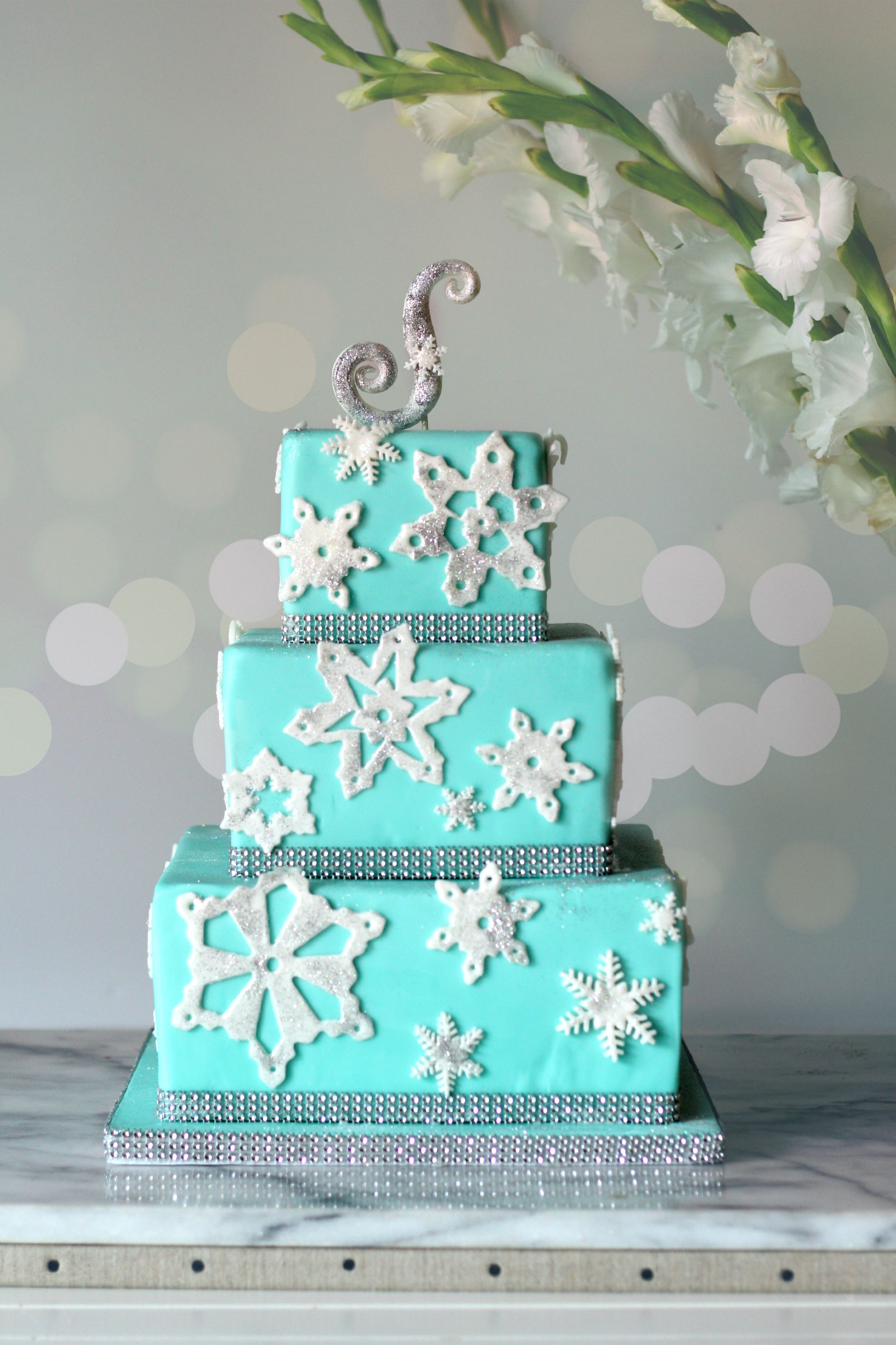Frozen themed cake with 3 square tiers bokeh.jpg