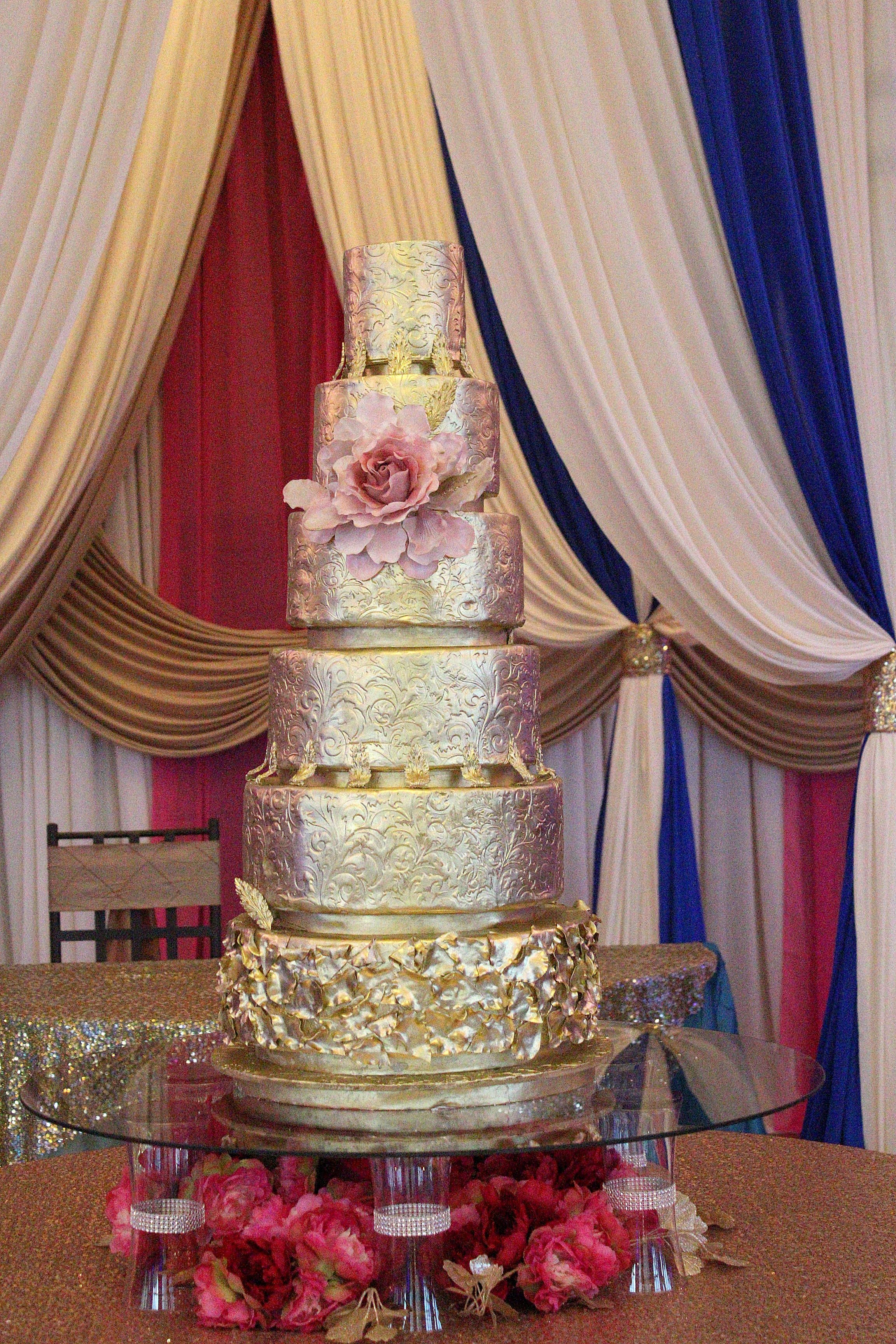 6 tier gold embossed wedding cake