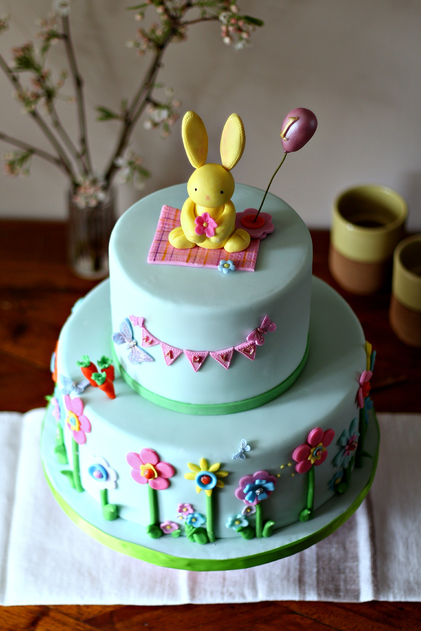 Bunny birthday cake flat sugar flowers pennant edit.jpg
