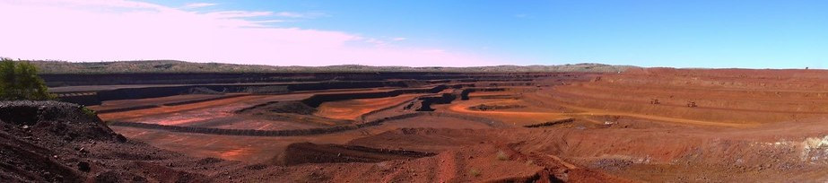 A wide shot of the red Yandi iron ore mine in Australia