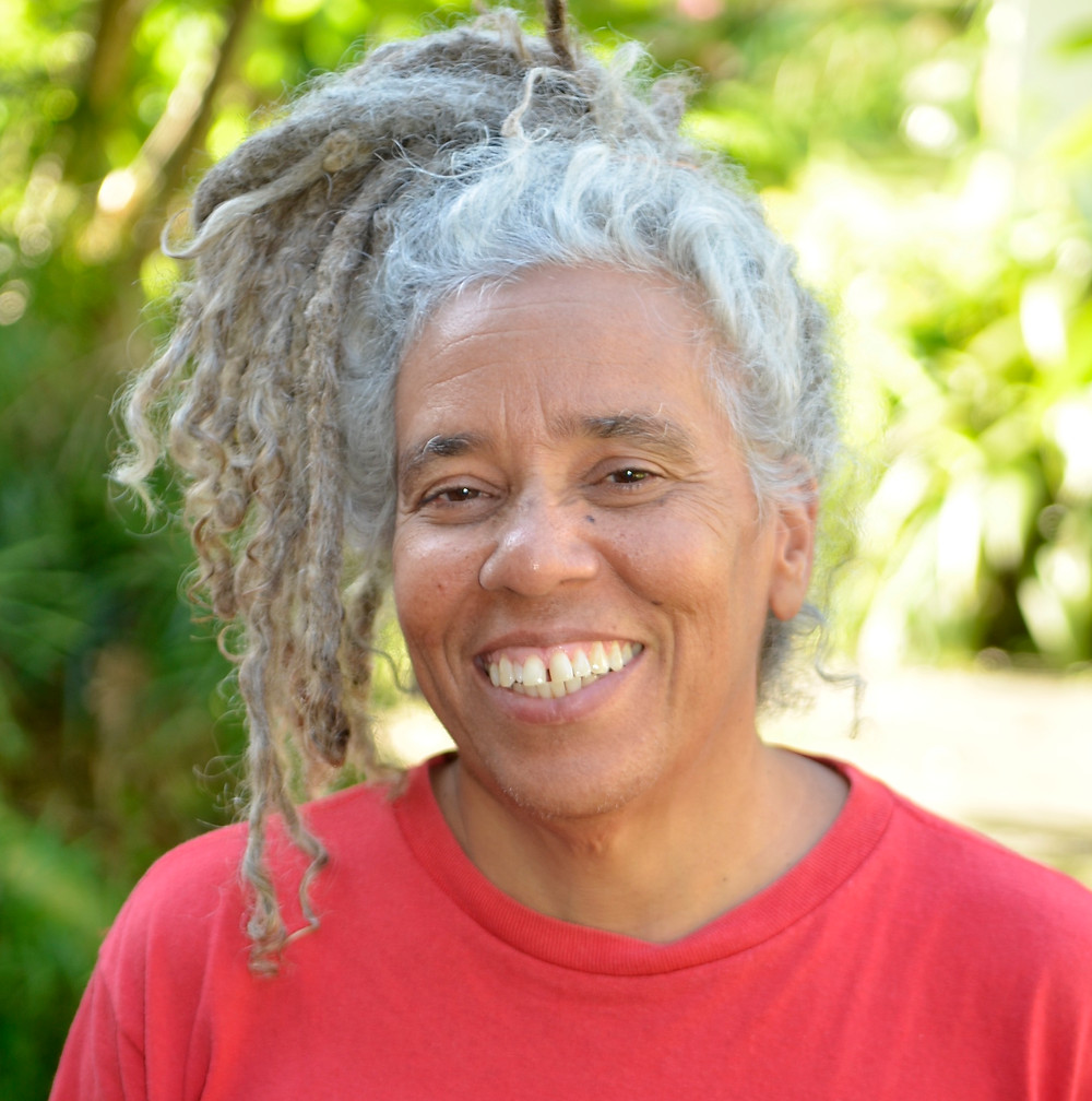 Esther Figueroa PhD, Jamaican independent film maker, writer, educator and linguist. Her activist film making gives voice to  those outside of mainstream media and  focuses on the perpetuation of local and indigenous knowledge, environment, social injustice, and community empowerment.