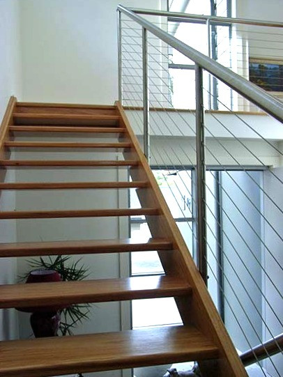 timber staircase with stainless steal balustrade image