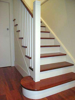 White and stained timber stairs by Budget Stairs