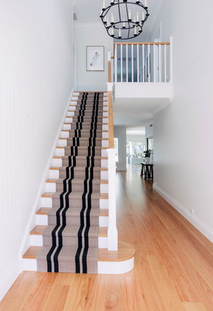 Contemporary staircase design with timber carpet runner stairs by Budget Stairs