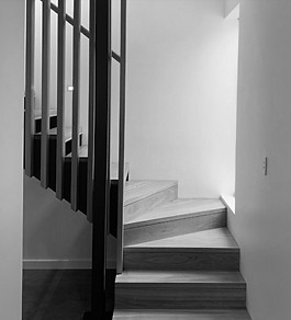 timber staircase black and white image