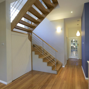 Timber staircase with steel balustrades and timber handrails by Budget Stairs