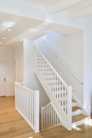 white staircase timber stairs by Budget Stairs