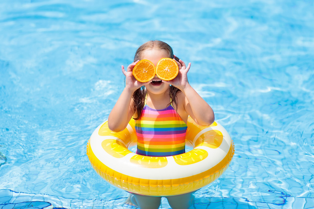 Child in Vacation Rental Swimming Pool with floatie