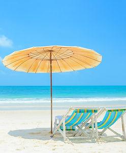 Beach Chair and umbrellas on Beach.jpg