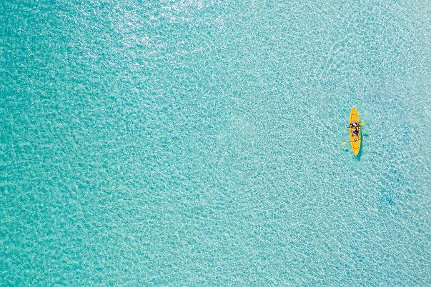 Yellow Kayak in Water.jpg