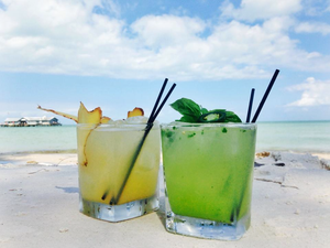 Cocktails on the beach next to Anna Maria Island City Pier