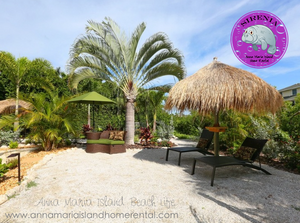 Lounging areas on backyard beach at Sirenia Beach House