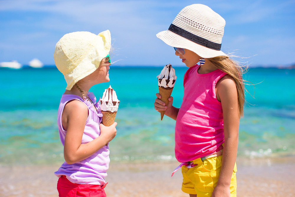 Girls eating ice cream on the beach