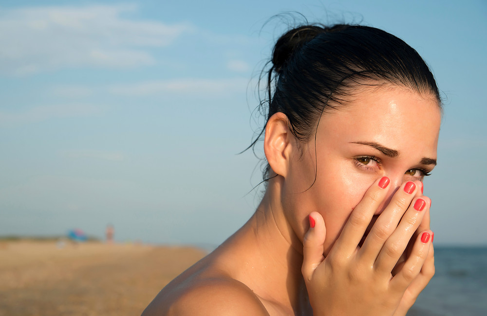 Person coughing at the beach