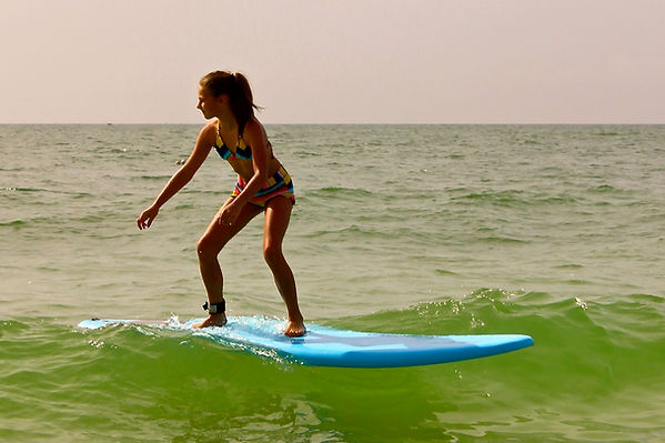 Girl Surfing at Anna Maria Island, Florida