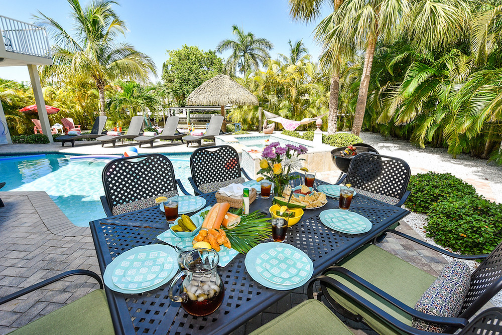 Dining Outdoors at Sirenia By The Sea Vacation Rental