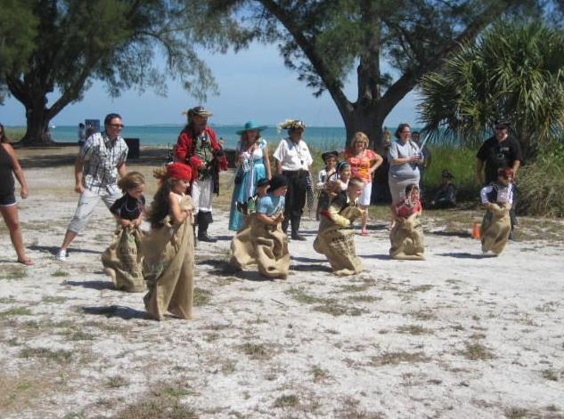 Snook Adam's Day potato sack races Anna Maria Island