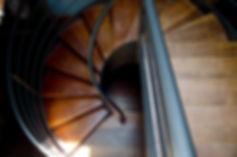 Sarah Watermeyer Design hard wood spiral staircase with black steel railing
