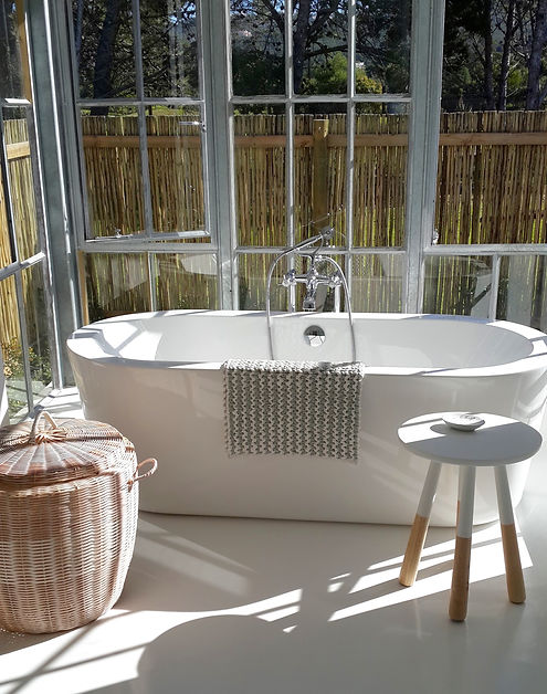 Sarah Watermeyer Design bright bathroom with freestanding tub and minimalist finishes