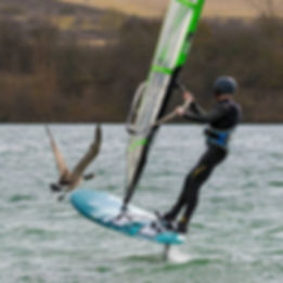 windfoil flying with a goose ahead over broglake clean water near milton keynes and beford windsurfin rocks