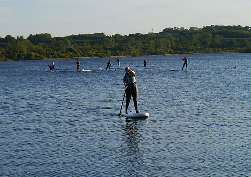 group of friends SUP stand up paddle at broglake bedford milton keynes close to northampton blue water summer fun