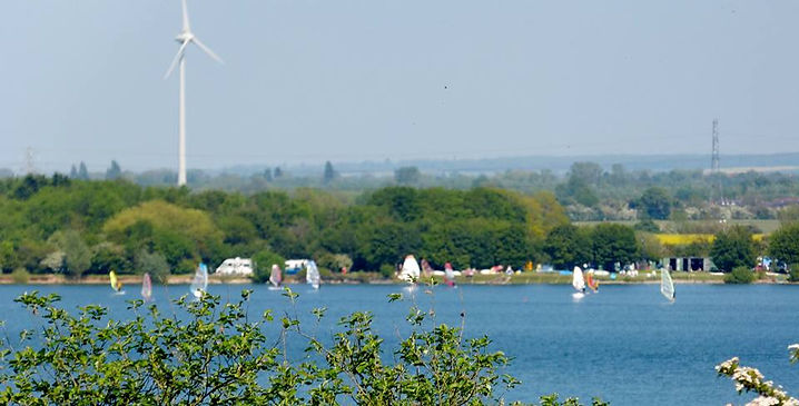 sunny summer windsuf learning, sup, windmill, blue water bedford milton keynes windturbine marston mortine