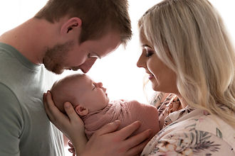 Family newborn session with mum and dad