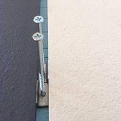 יישום חיפוי חזיתות בניינים באריחי פורצלן עם עיגון מכאני ובידוד חיצוני