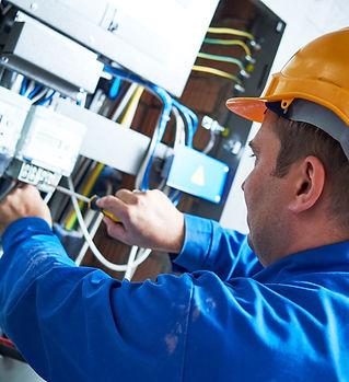 Electrician installing energy saving met