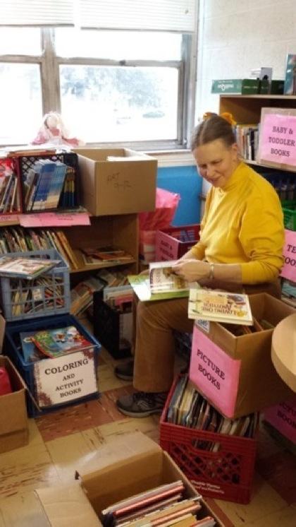 P. 8 Anne  Hayner pciking books.jpg