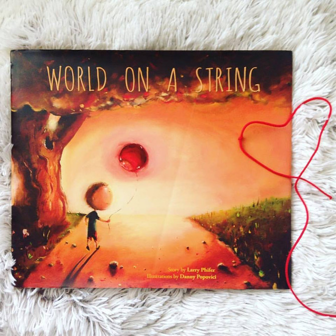 """World on a String""  by Larry Phifer illustrated by Danny Popovici"