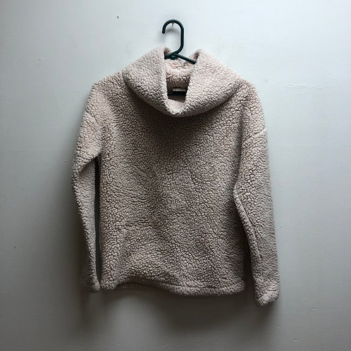 A new day light pink Sherpa-like cowl neck sweater