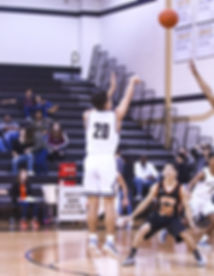 man in white and black number 20 jersey shirt shooting a basketball_edited_edited.jpg