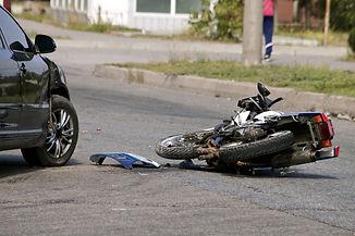 crash moto bike and car on road.jpg