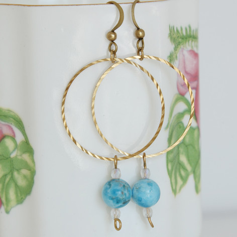 Copper wire hoop earrings with blue apaptite gem