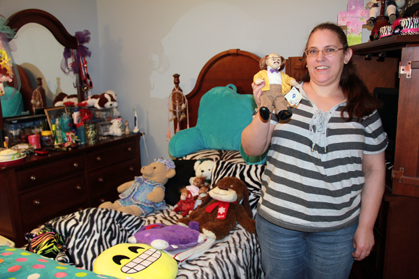 Beth's bedroom at Lanier Home. It is decorated in zebra prints and showcases the many dolls in her collection.